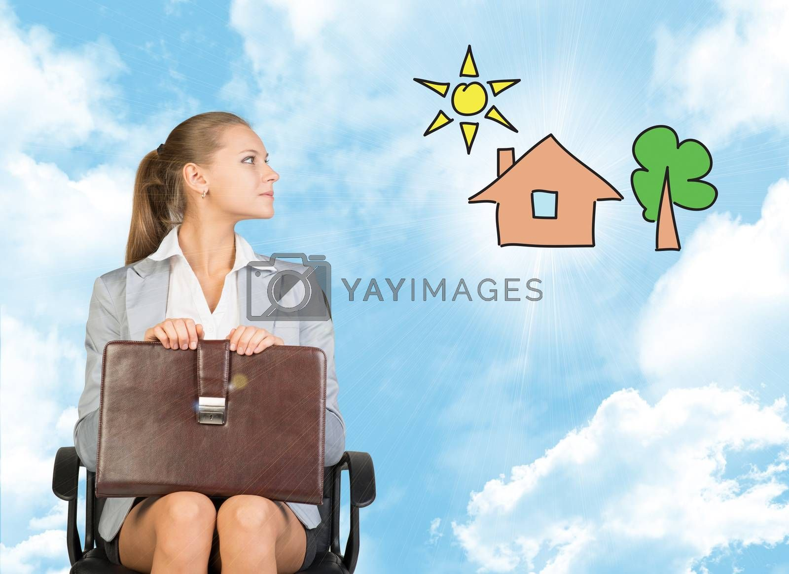 Business woman in skirt, blouse and jacket, sitting on chair imagines house with tree. Against background of blue sky and clouds