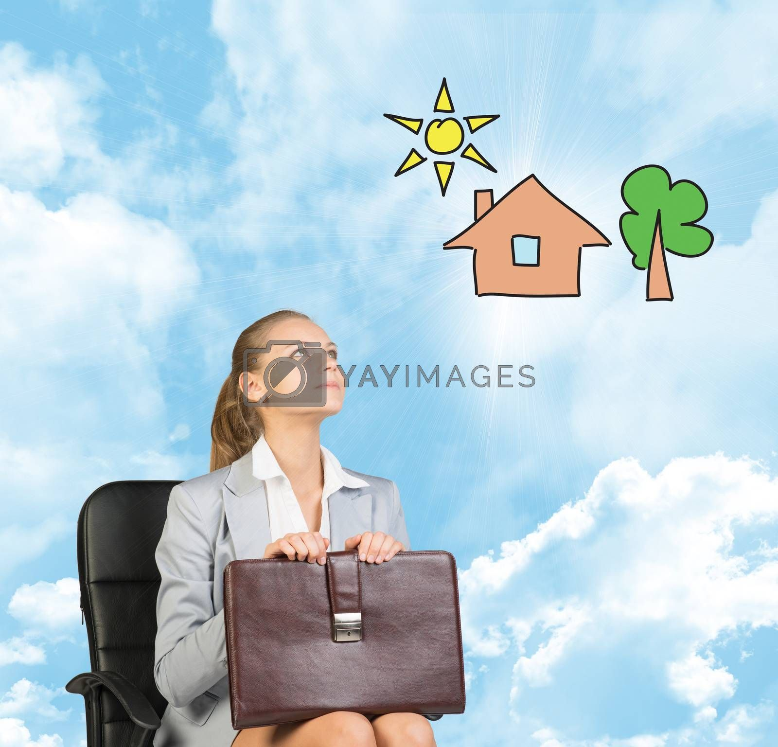 Business woman in skirt, blouse and jacket, sitting on chair and holding briefcase imagines house with tree. Against background of blue sky and clouds