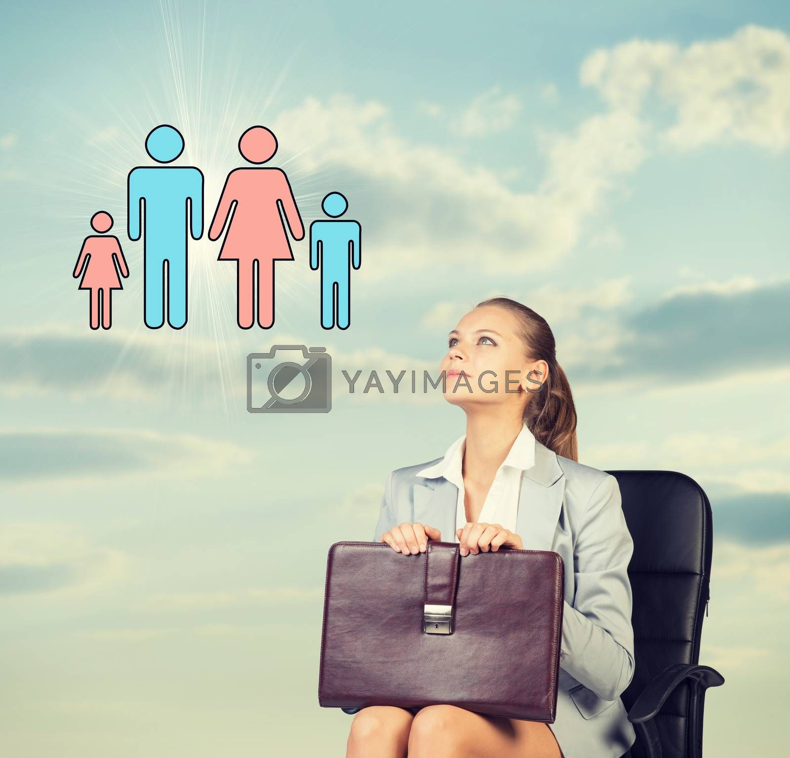 Business woman in skirt, blouse and jacket, sitting on chair imagines family. Against background of sky and clouds