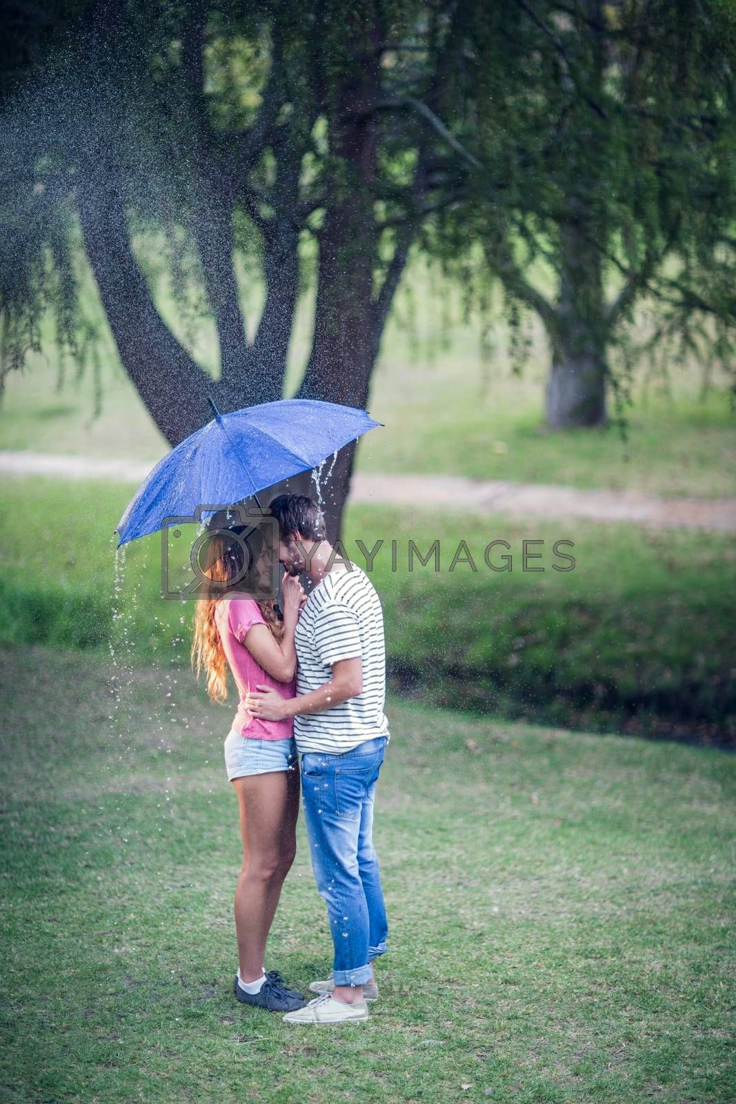 young people in the park on the raining day