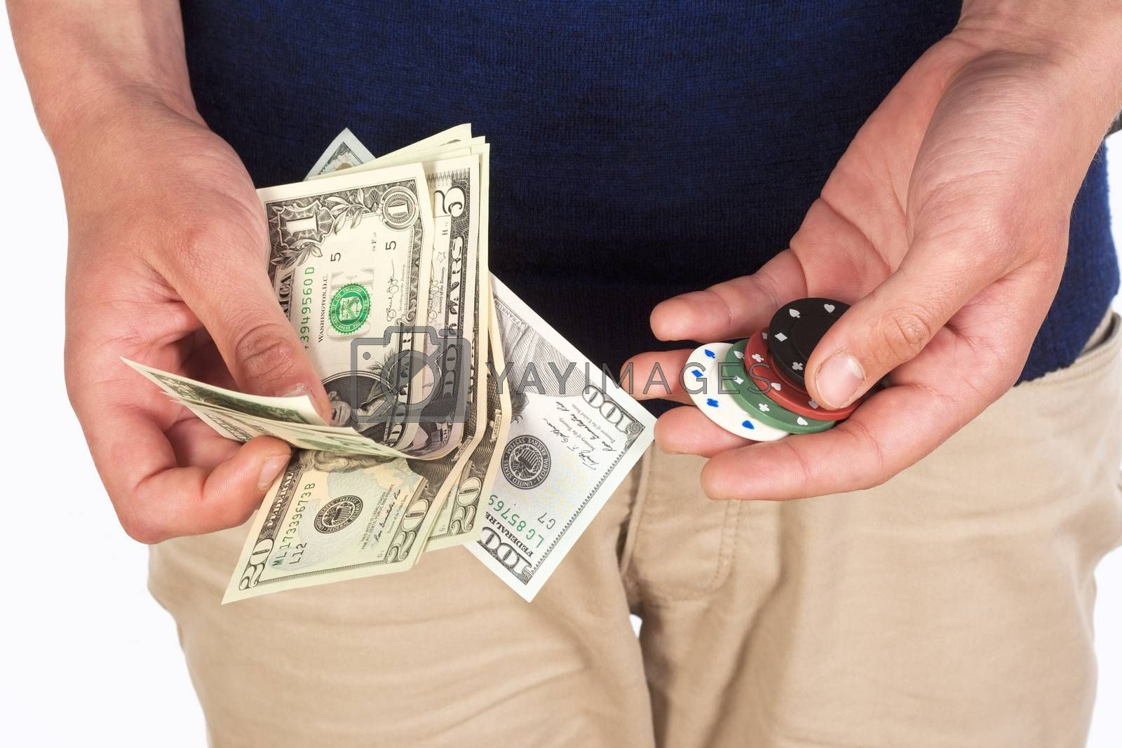 Royalty free image of Man Holding Dollar Bills and Casino Chips. by courtyardpix