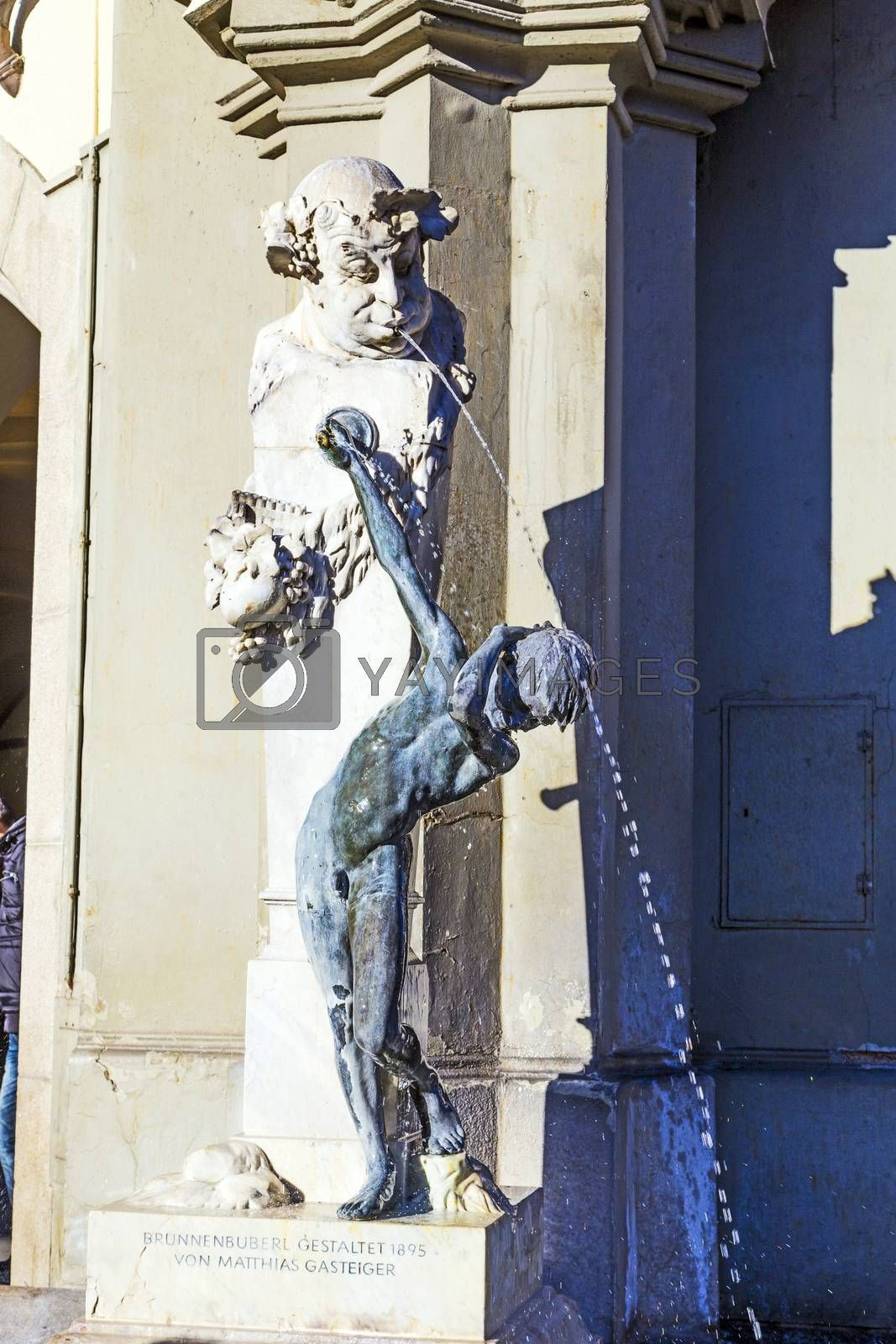 MUNICH, GERMANY - DEC 27, 2013: famous fountain Brunnenbuberl in Munich, Germany., Mathias Gasteiger created that sculpture in 1895.
