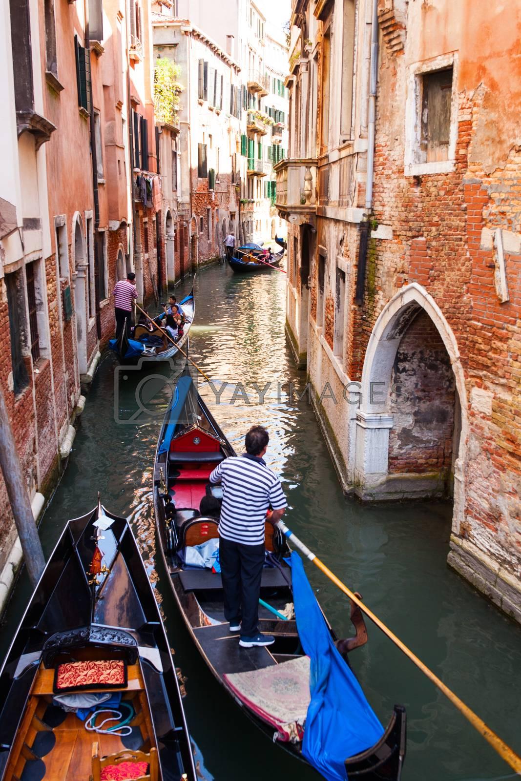 Gondolier in Venice by bepsimage