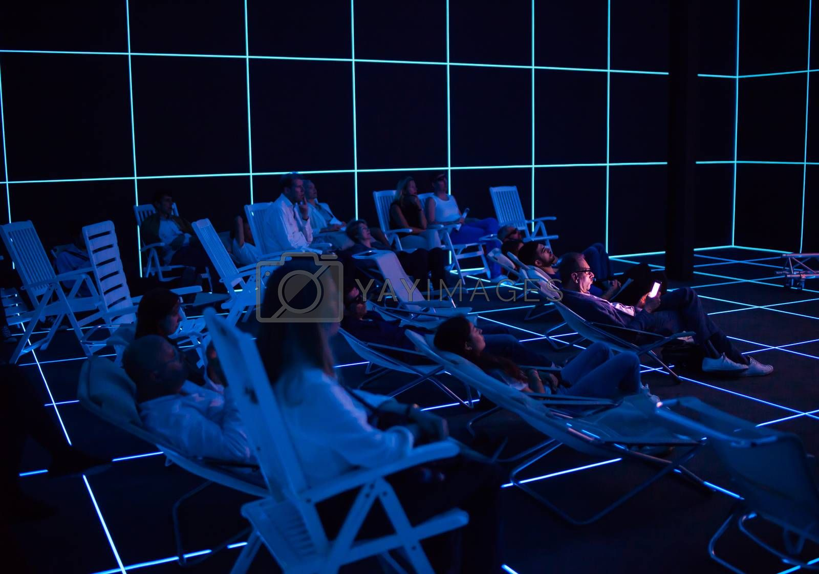 "VENICE, ITALY - MAY 06: People looking ""Factory of the Sun"" video installation by Hito Steyerl at German pavilion during the 56th Venice Biennale on May 06, 2015"