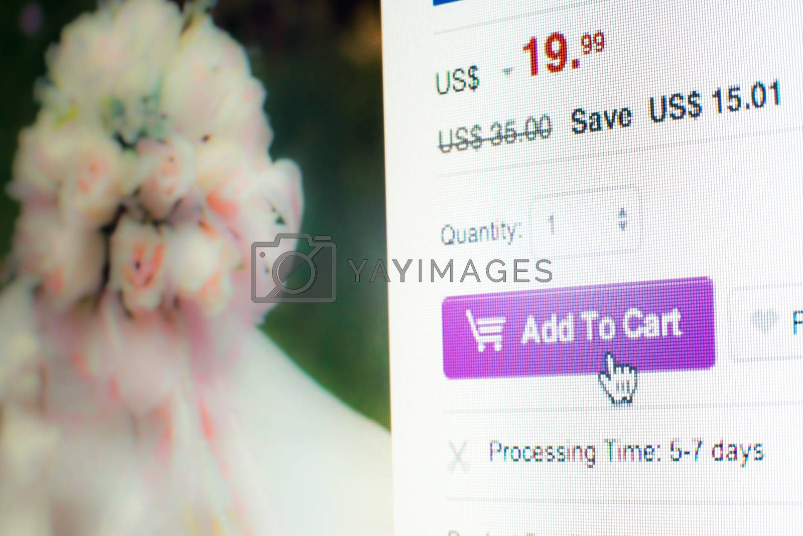 Royalty free image of Mouse clicking add to cart button on website by iamway