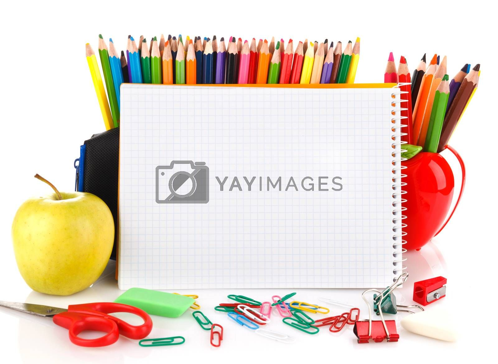 Notebook with school stationary objects in the background, place for text