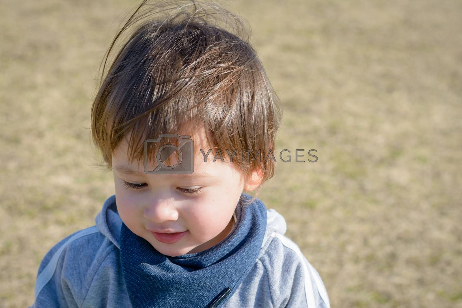 A 2 year old boy at a playground.