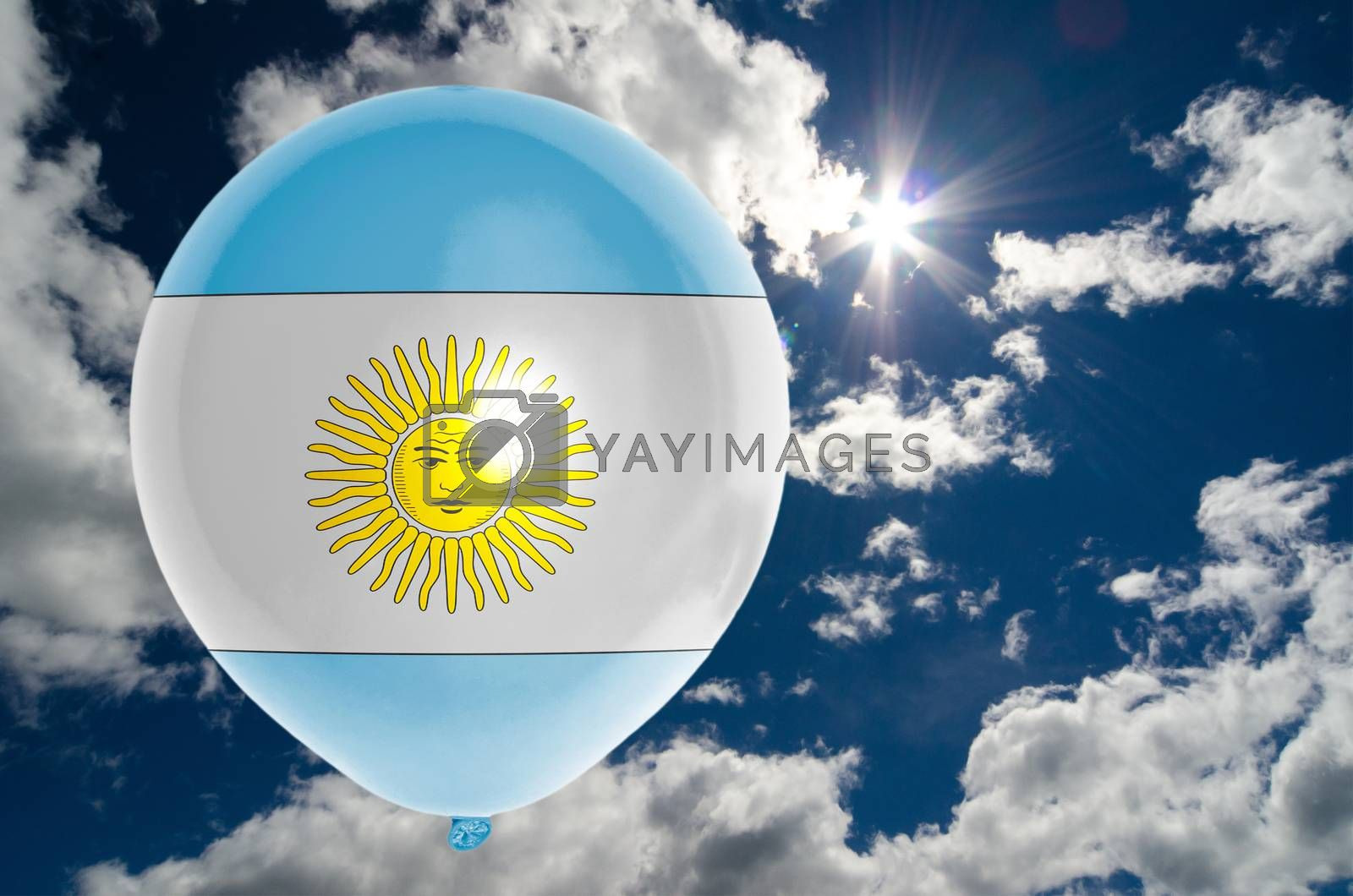 balloon in colors of argentina flag flying on blue sky