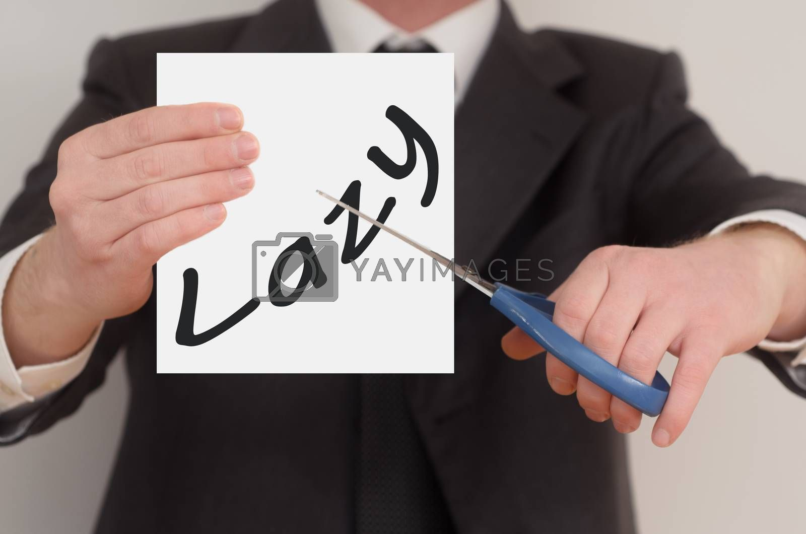 Lazy, man in suit cutting text on paper with scissors