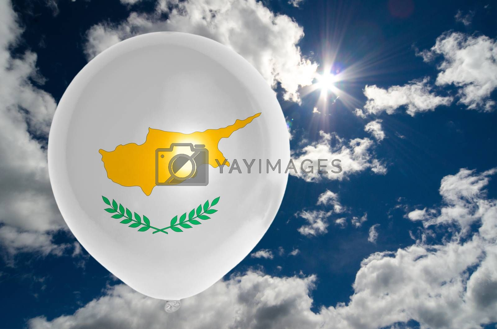 balloon in colors of cyprus flag flying on blue sky