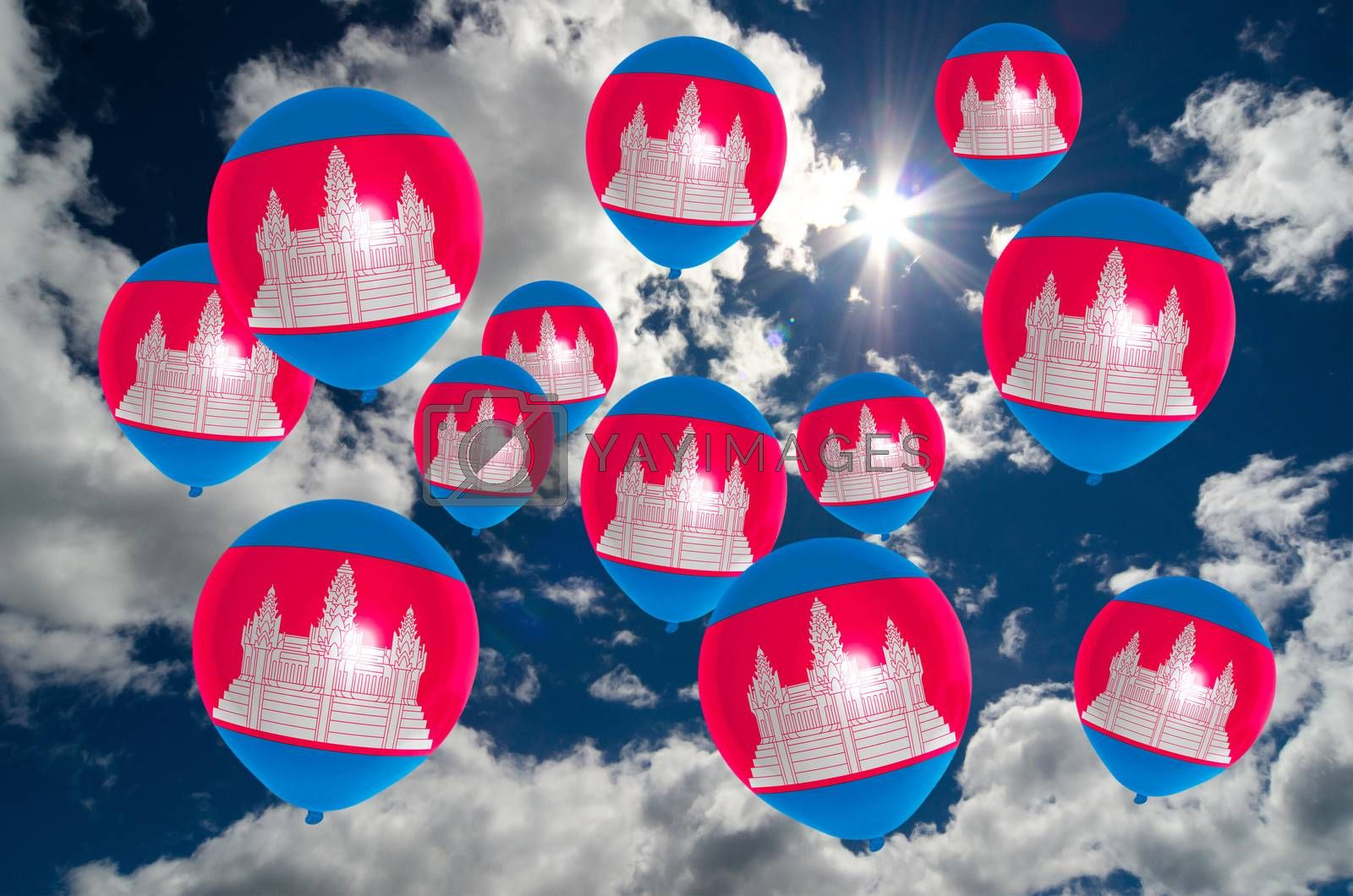 many ballons in colors of cambodia flag flying on sky
