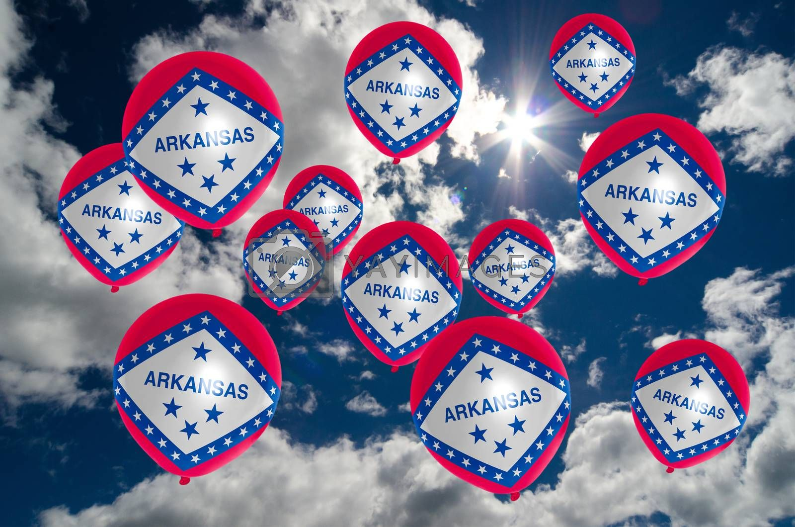 many ballons in colors of arkansas flag flying on sky