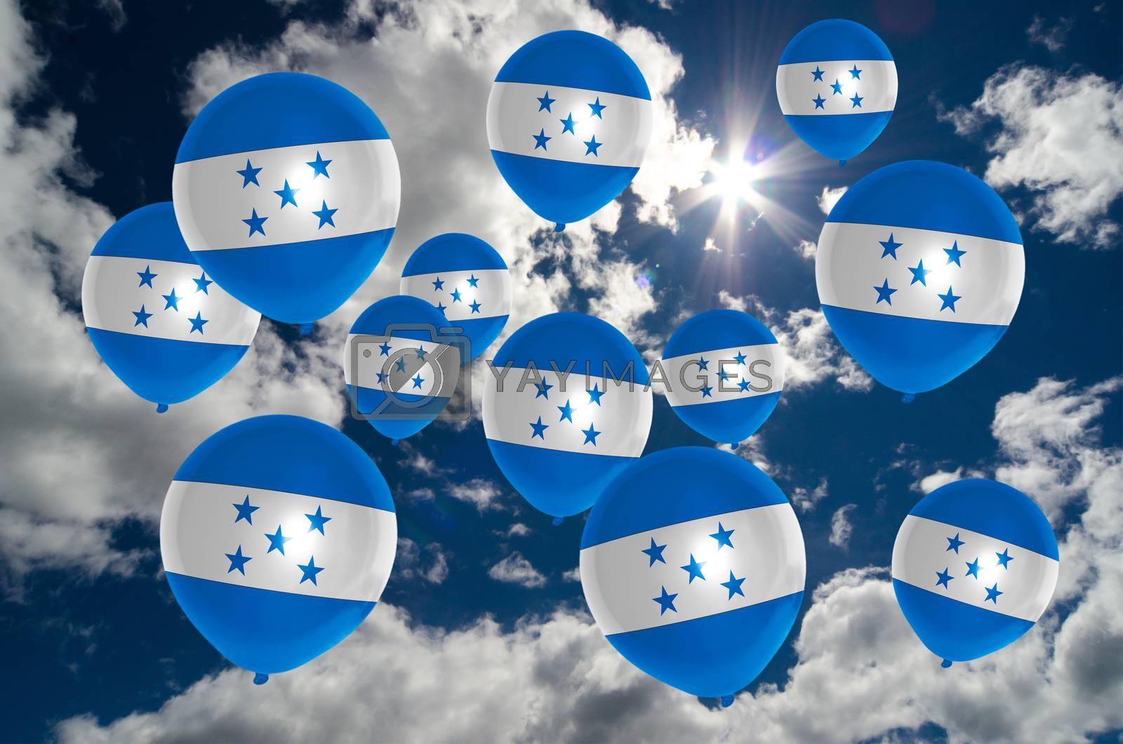 many ballons in colors of honduras flag flying on sky