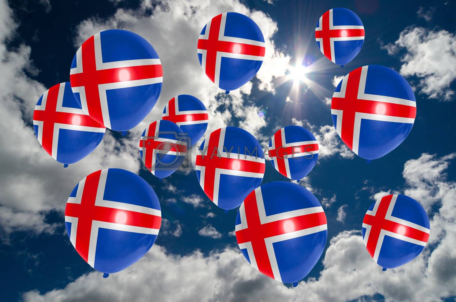 many ballons in colors of iceland flag flying on sky