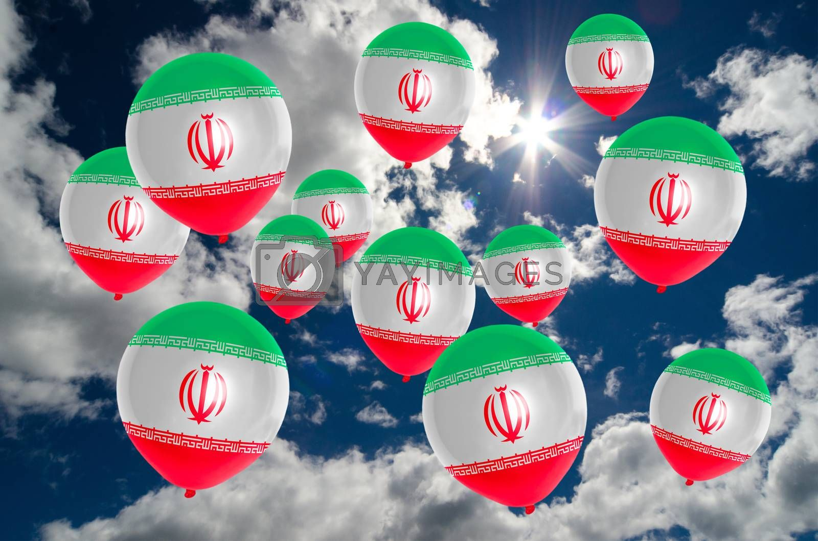 many ballons in colors of iran flag flying on sky