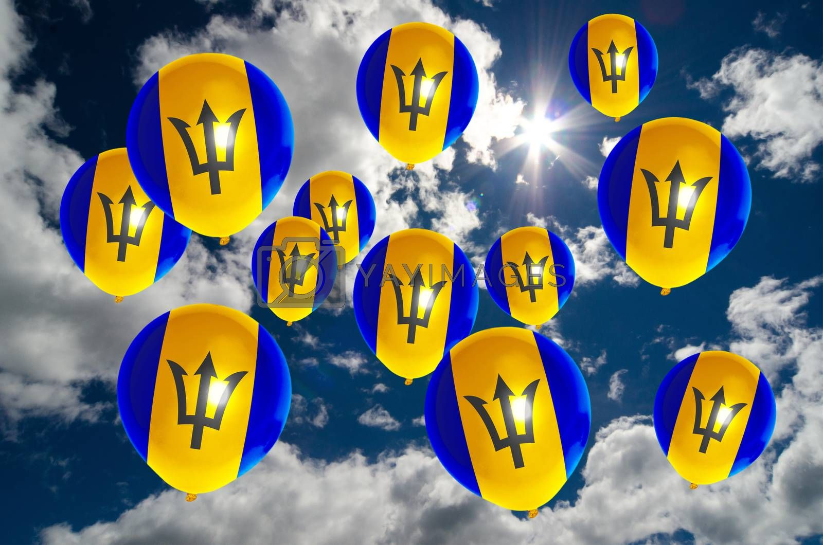many ballons in colors of barbados flag flying on sky
