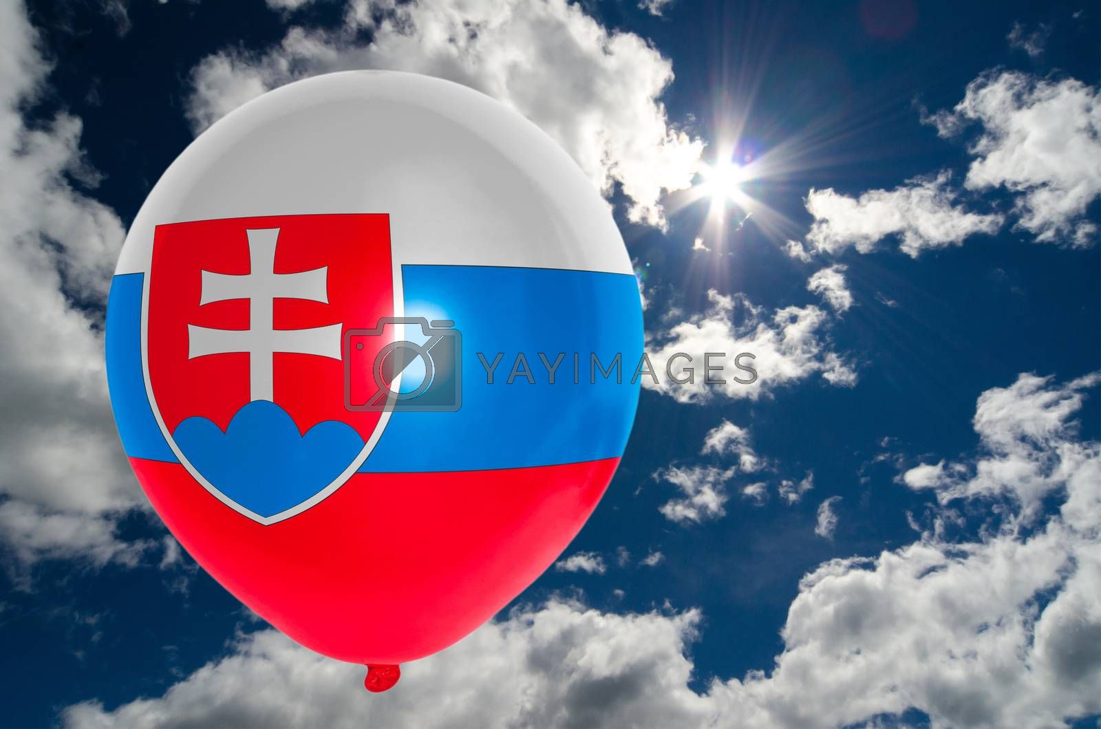 balloon in colors of slovakia flag flying on blue sky