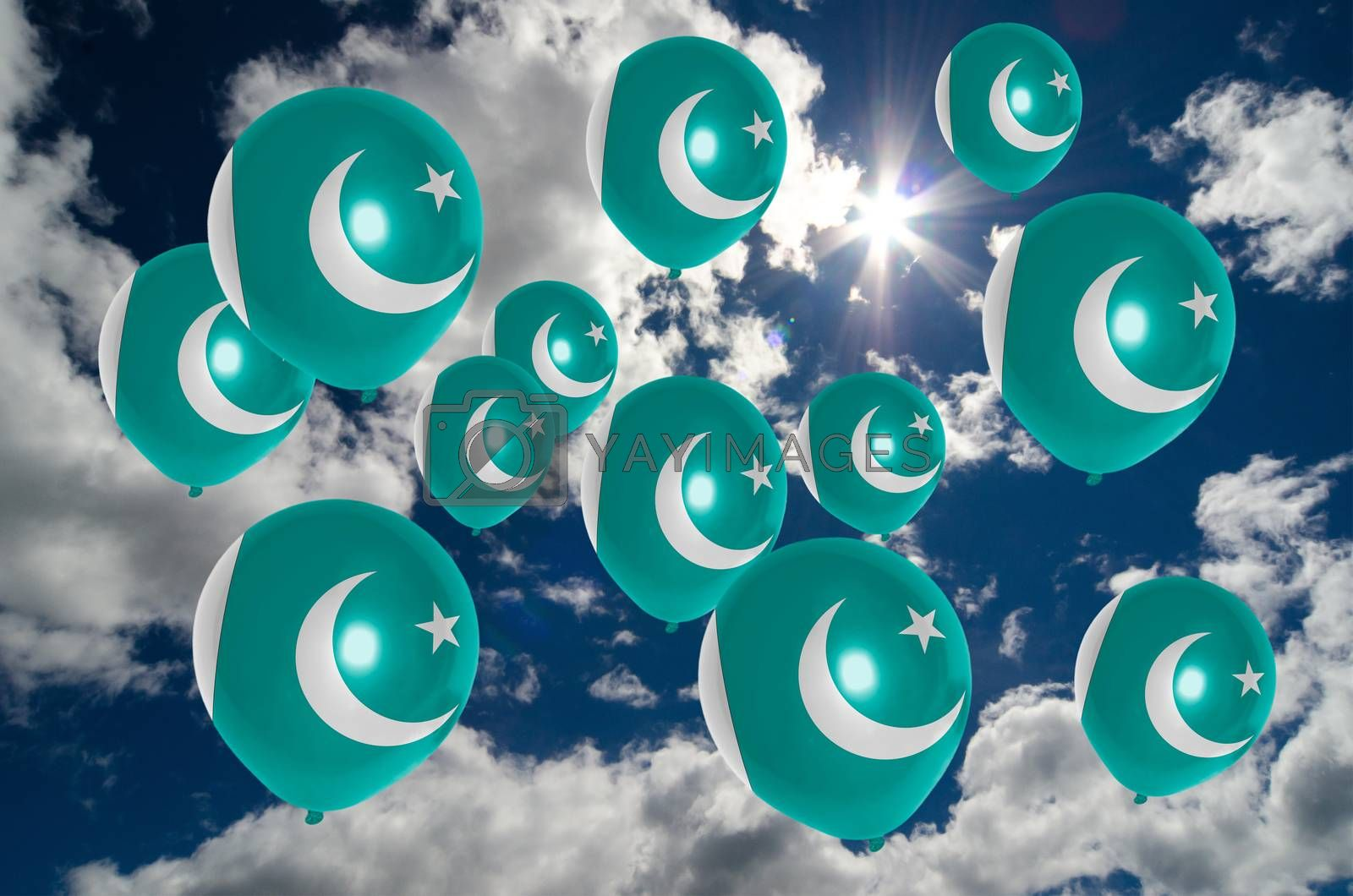 many ballons in colors of pakistan flag flying on sky