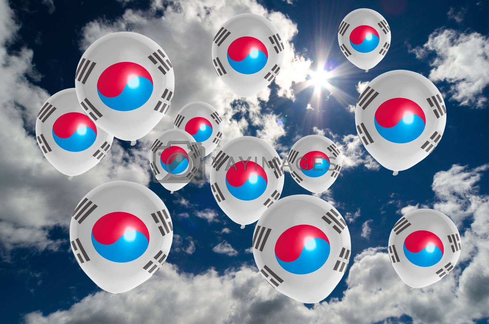 many ballons in colors of south korea flag flying on sky
