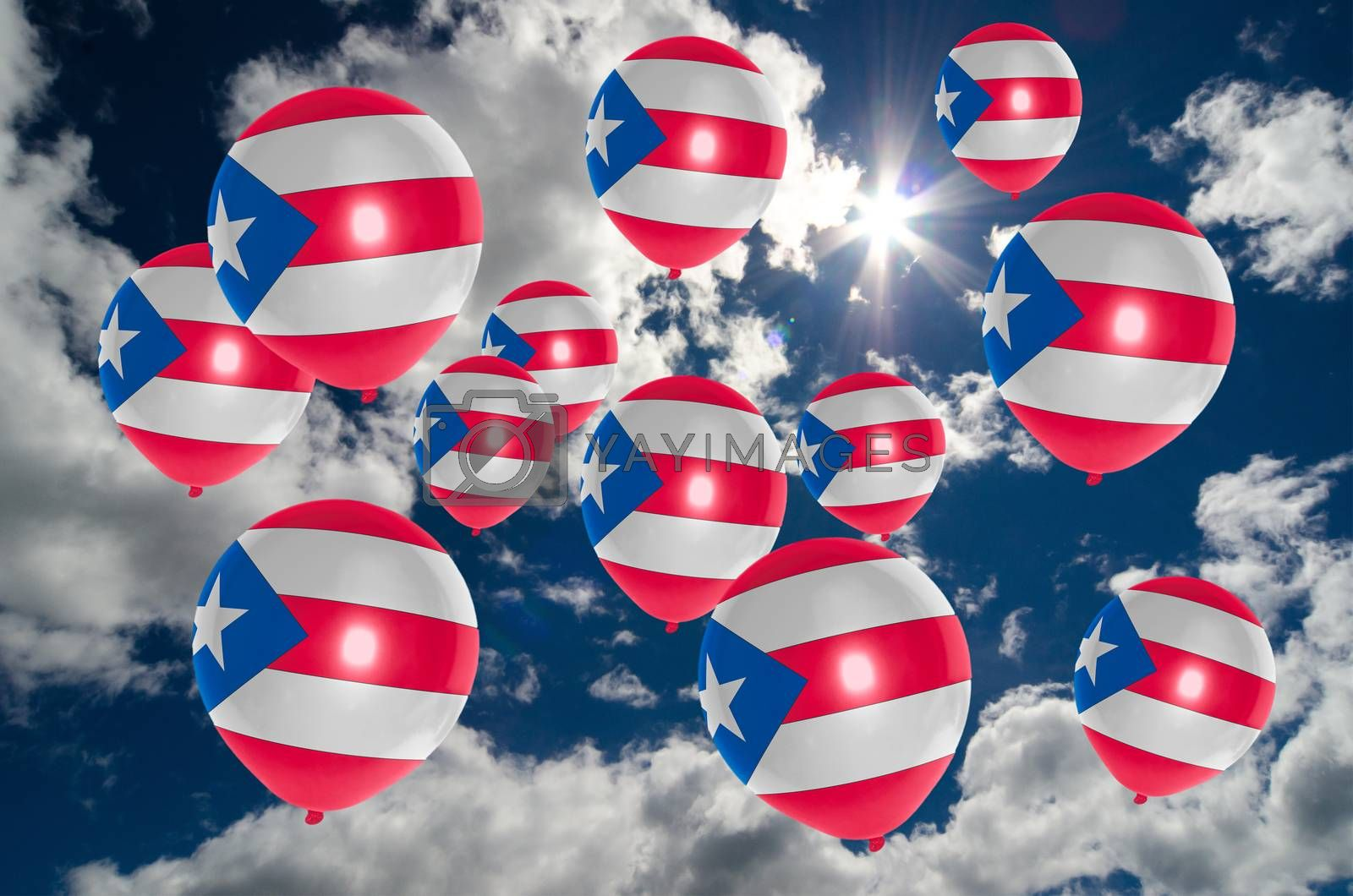 many ballons in colors of puerto rico flag flying on sky