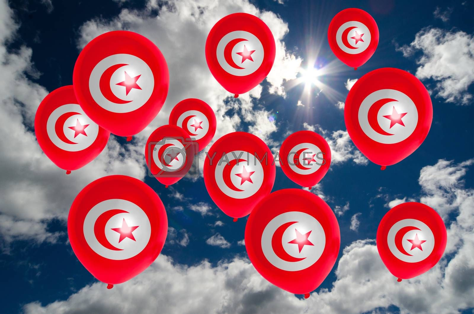 many ballons in colors of tunisia flag flying on sky