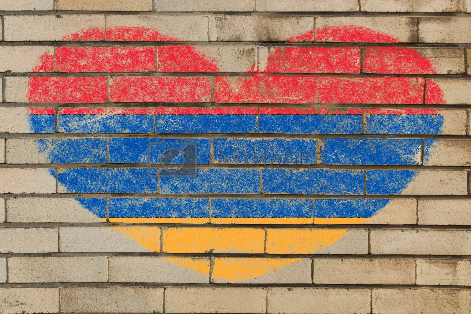 heart shaped flag in colors of armenia on brick wall
