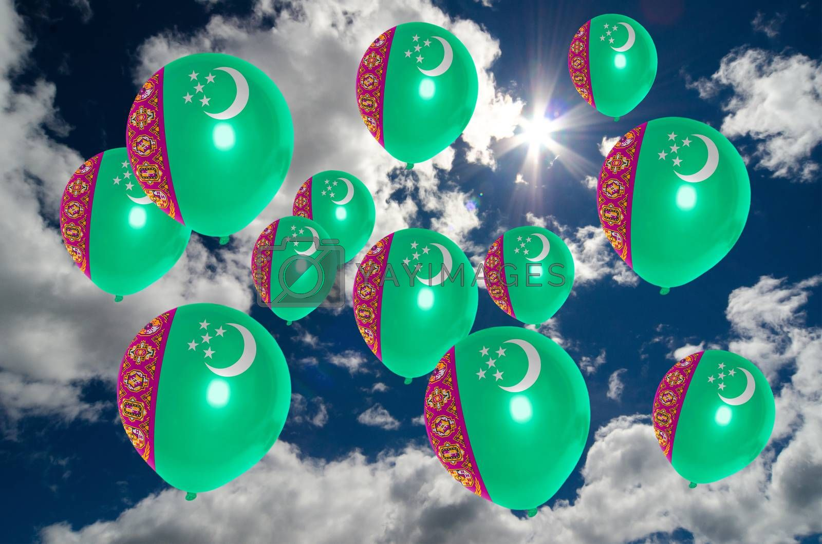 many ballons in colors of turkmenistan flag flying on sky