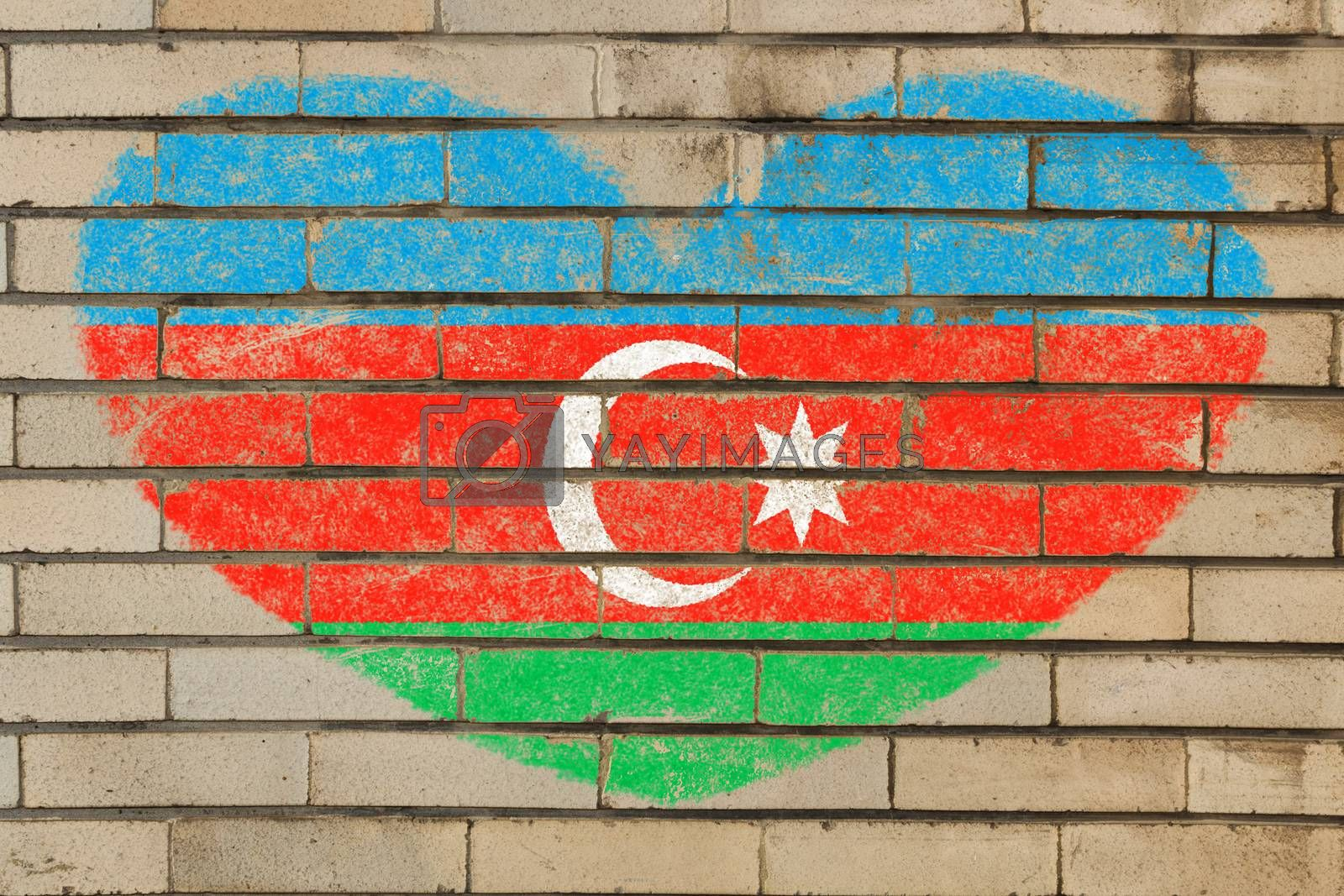 heart shaped flag in colors of azerbaijan on brick wall
