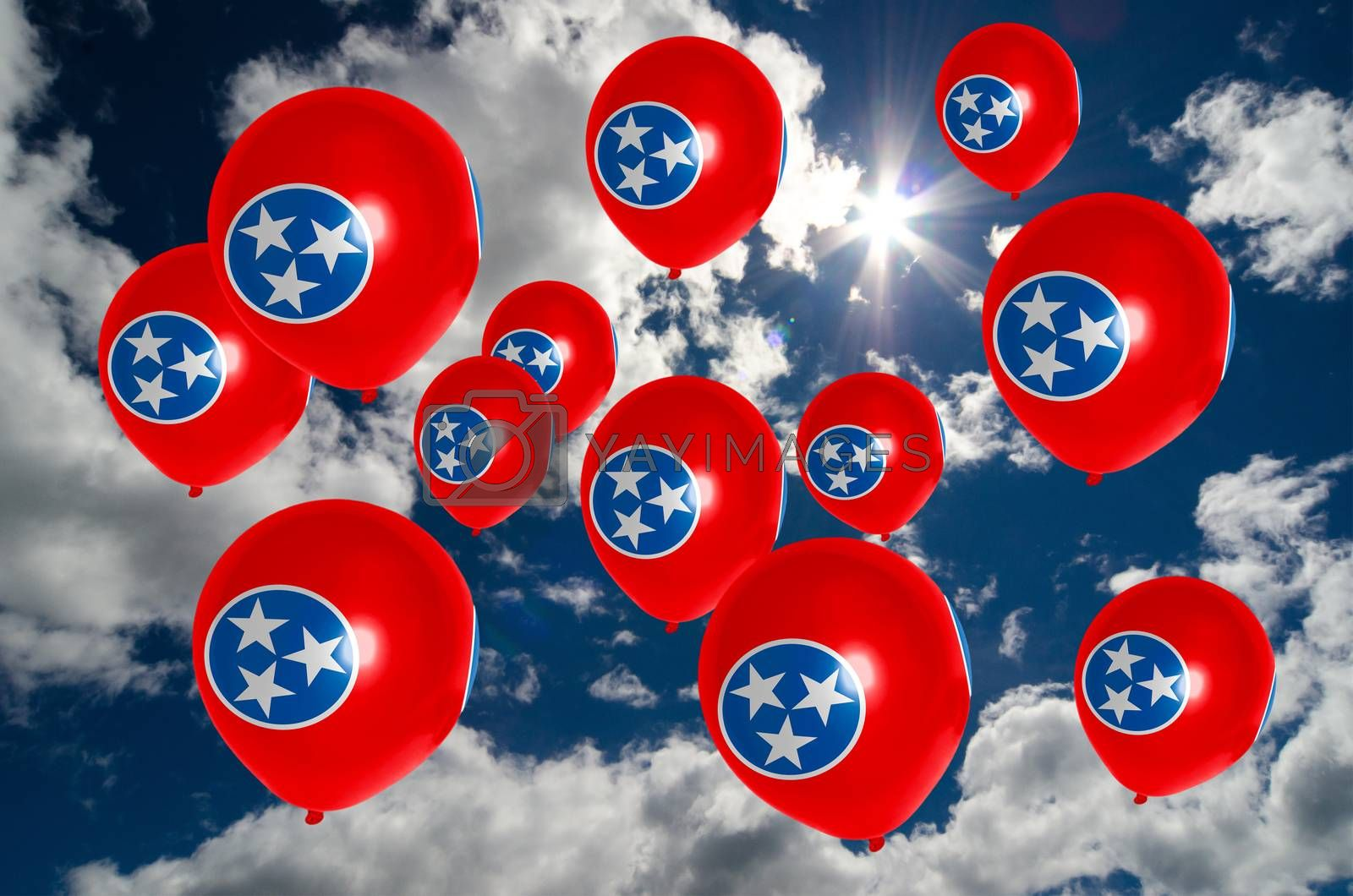 many ballons in colors of tennessee flag flying on sky
