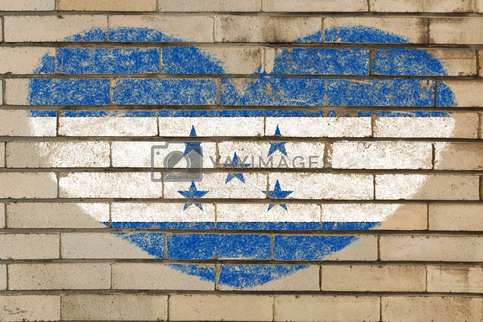 heart shaped flag in colors of honduras on brick wall