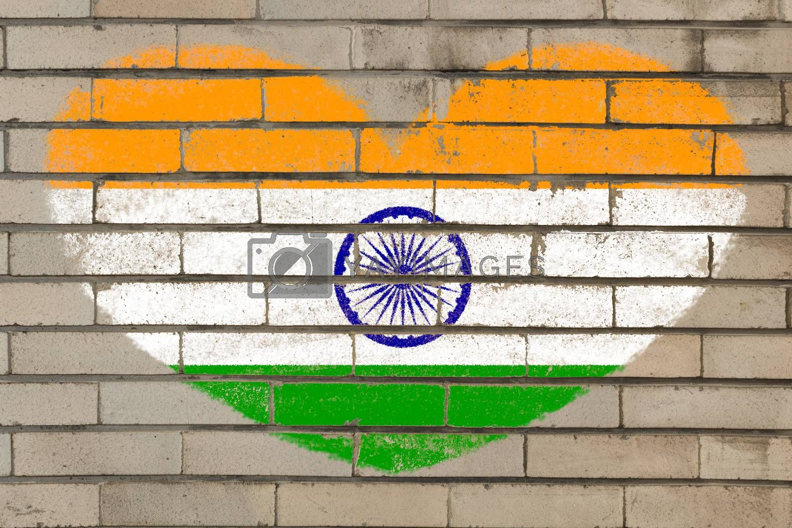 heart shaped flag in colors of india on brick wall