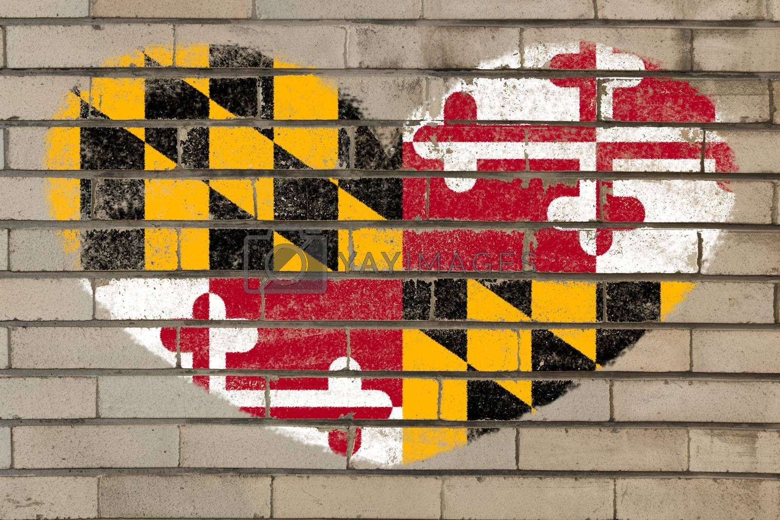 heart shaped flag in colors of maryland on brick wall