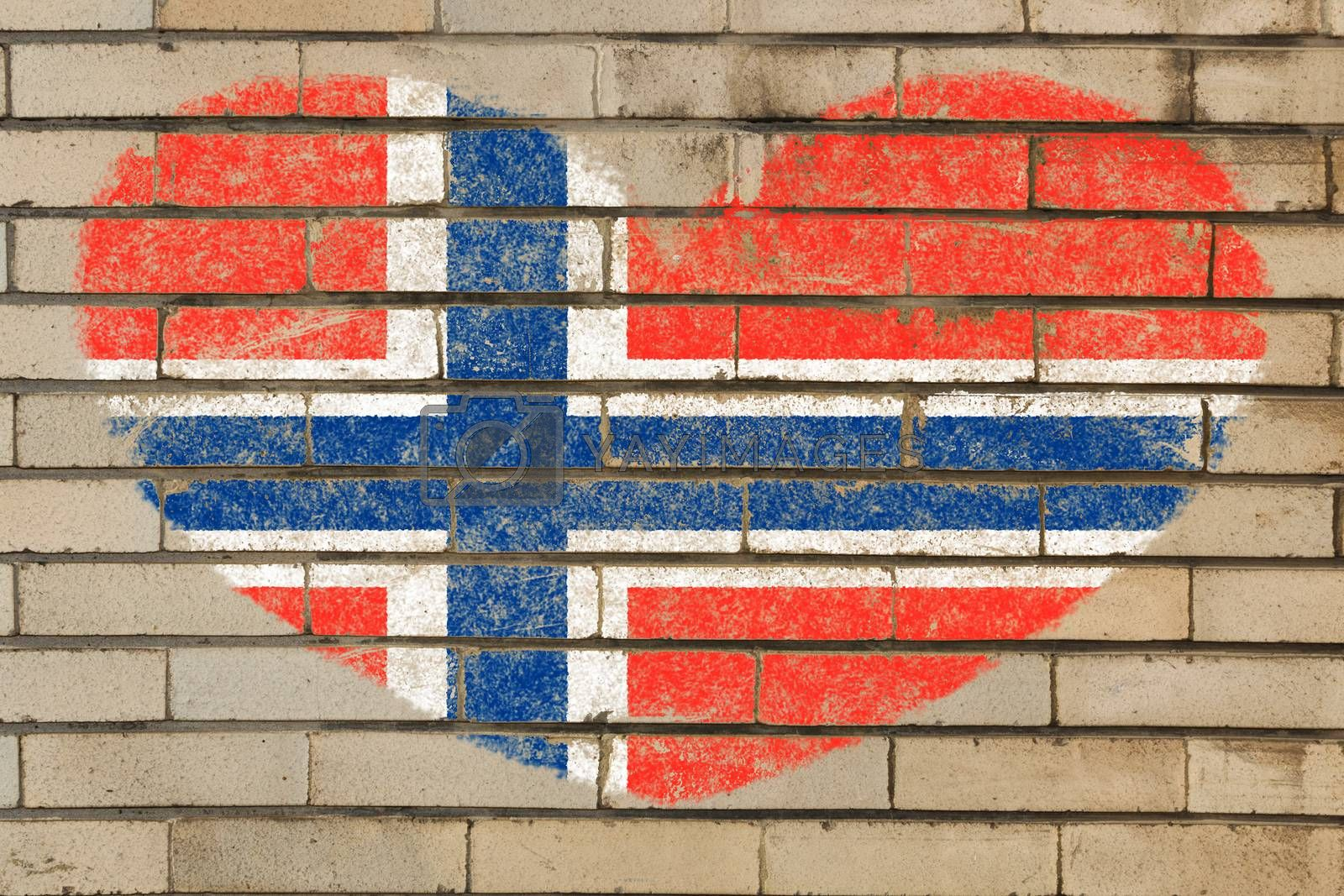 heart shaped flag in colors of norway on brick wall