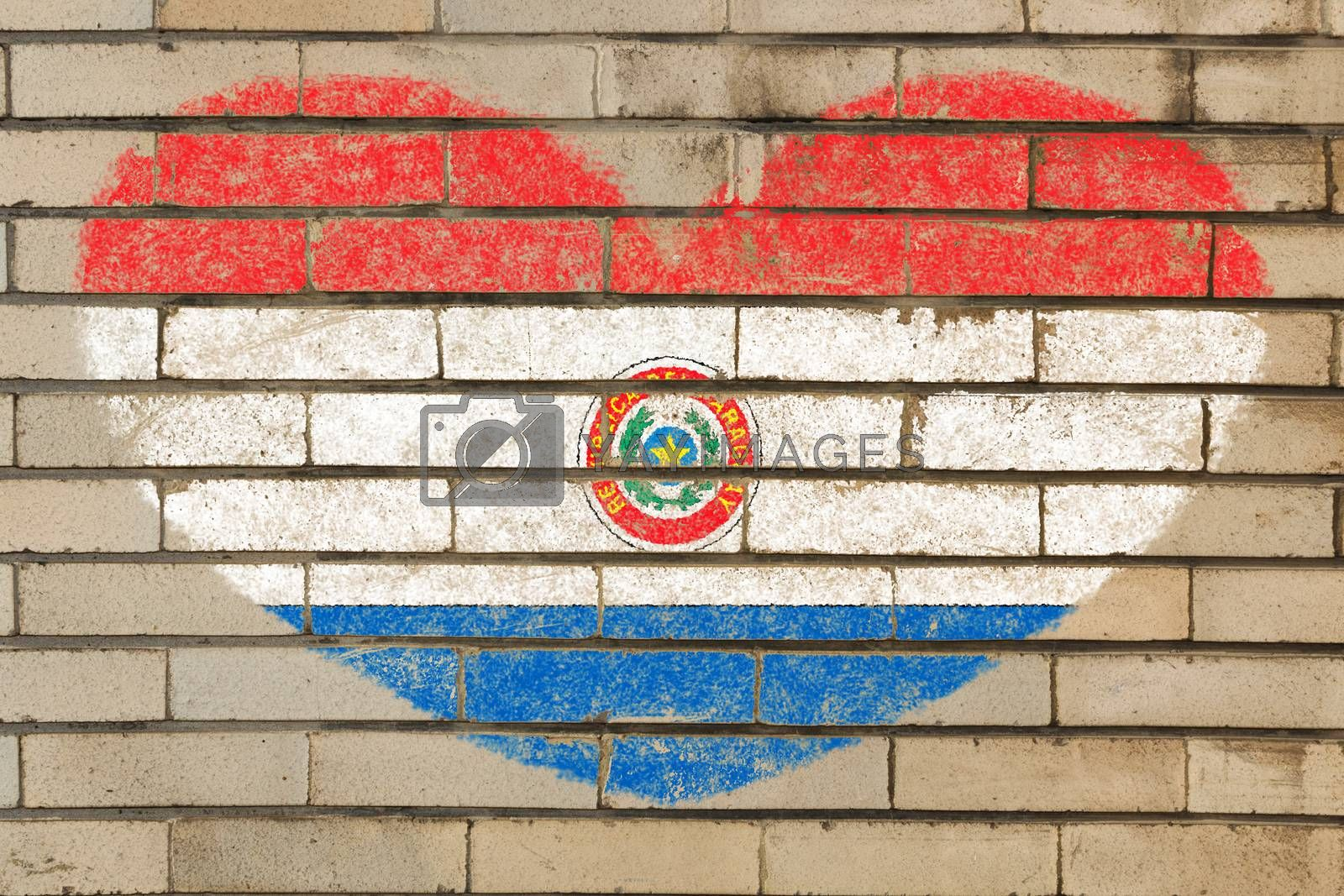 heart shaped flag in colors of paraguay on brick wall
