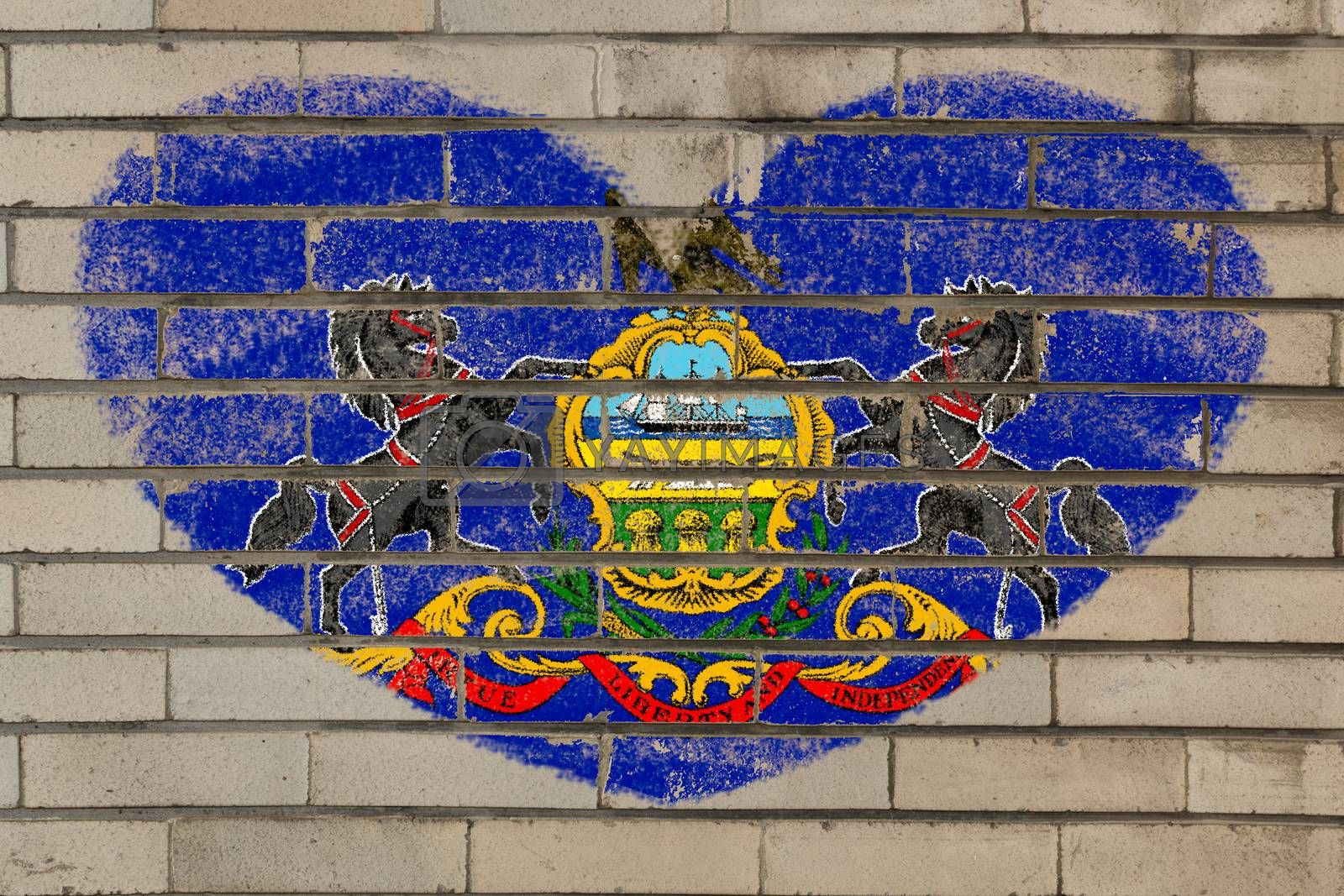 heart shaped flag in colors of pennsylvania on brick wall