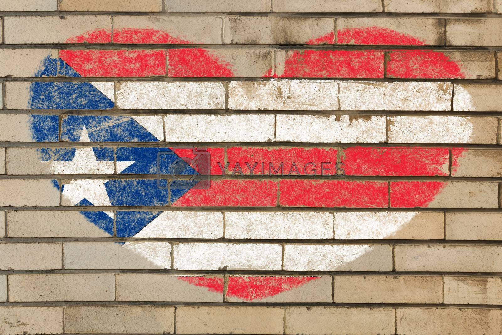 heart shaped flag in colors of puerto rico on brick wall