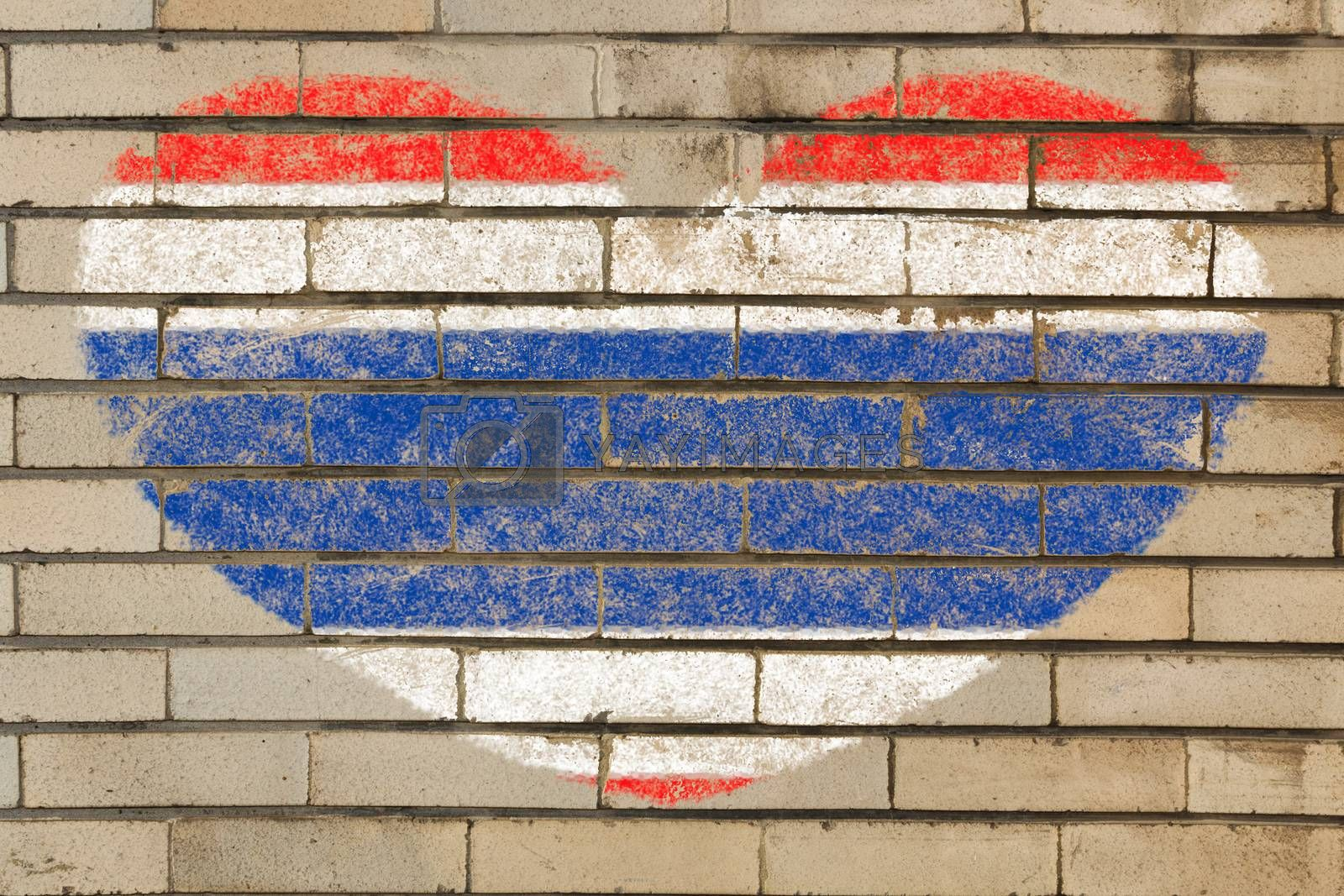 heart shaped flag in colors of Thailand on brick wall