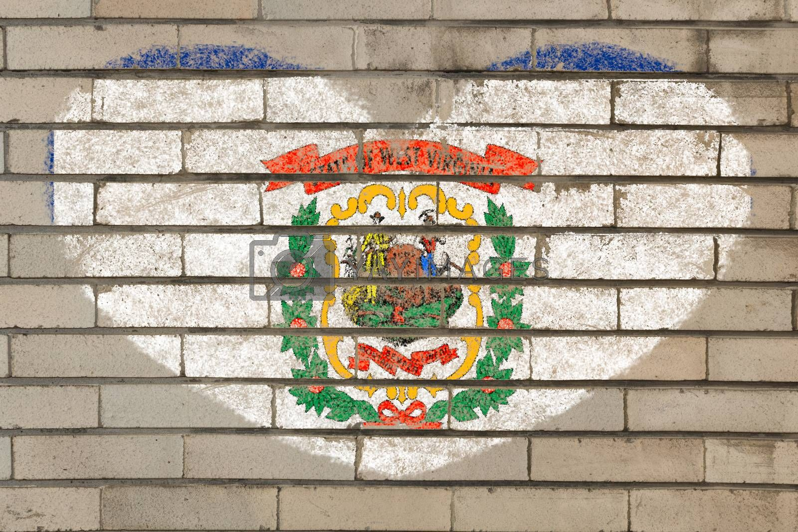 heart shaped flag in colors of west virginia on brick wall