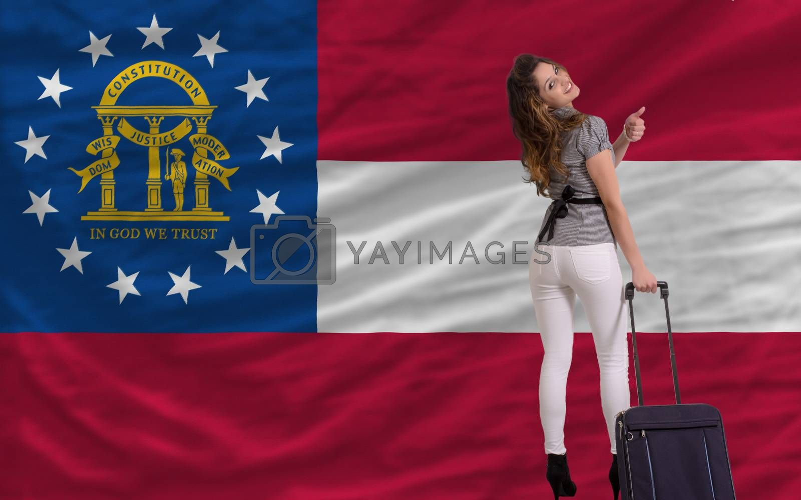 young beautiful woman is traveling to georgia