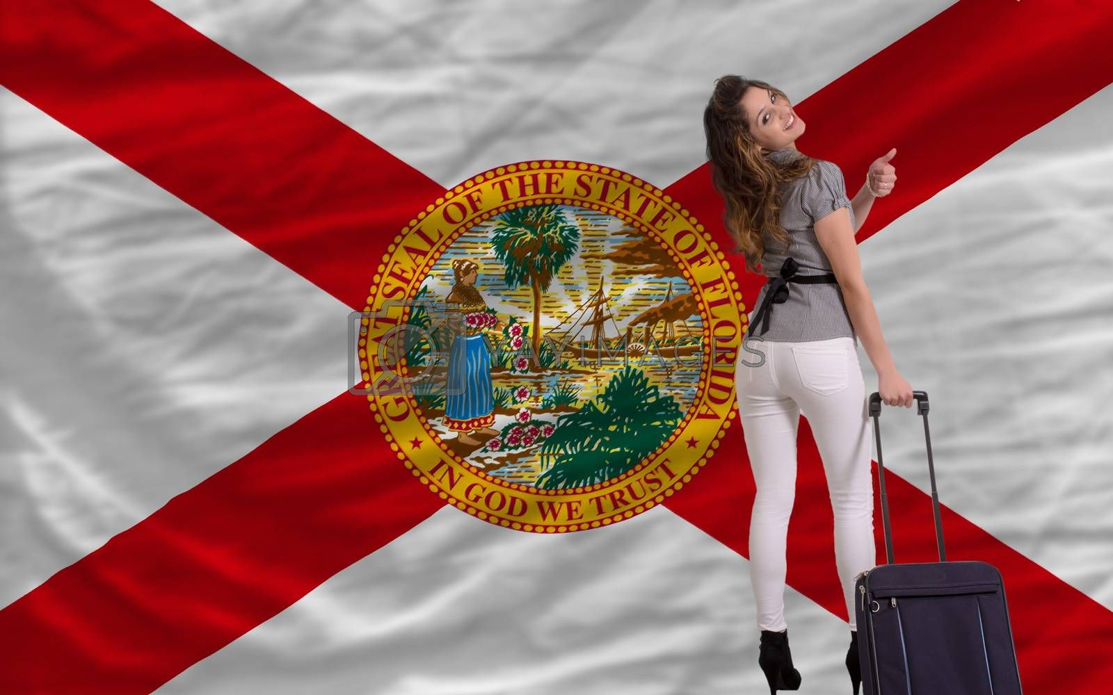 young beautiful woman is traveling to florida