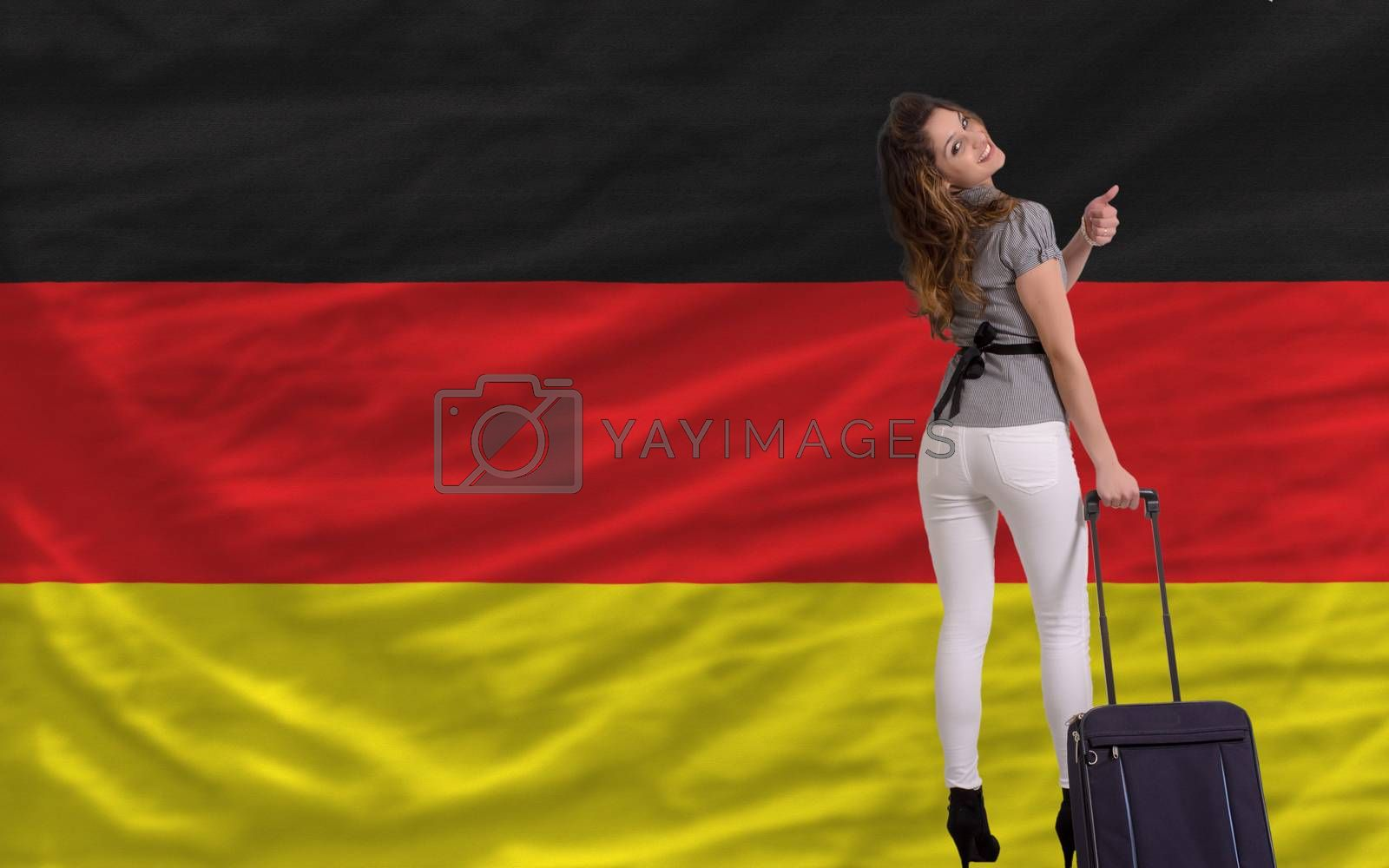 young beautiful woman is traveling to  germany