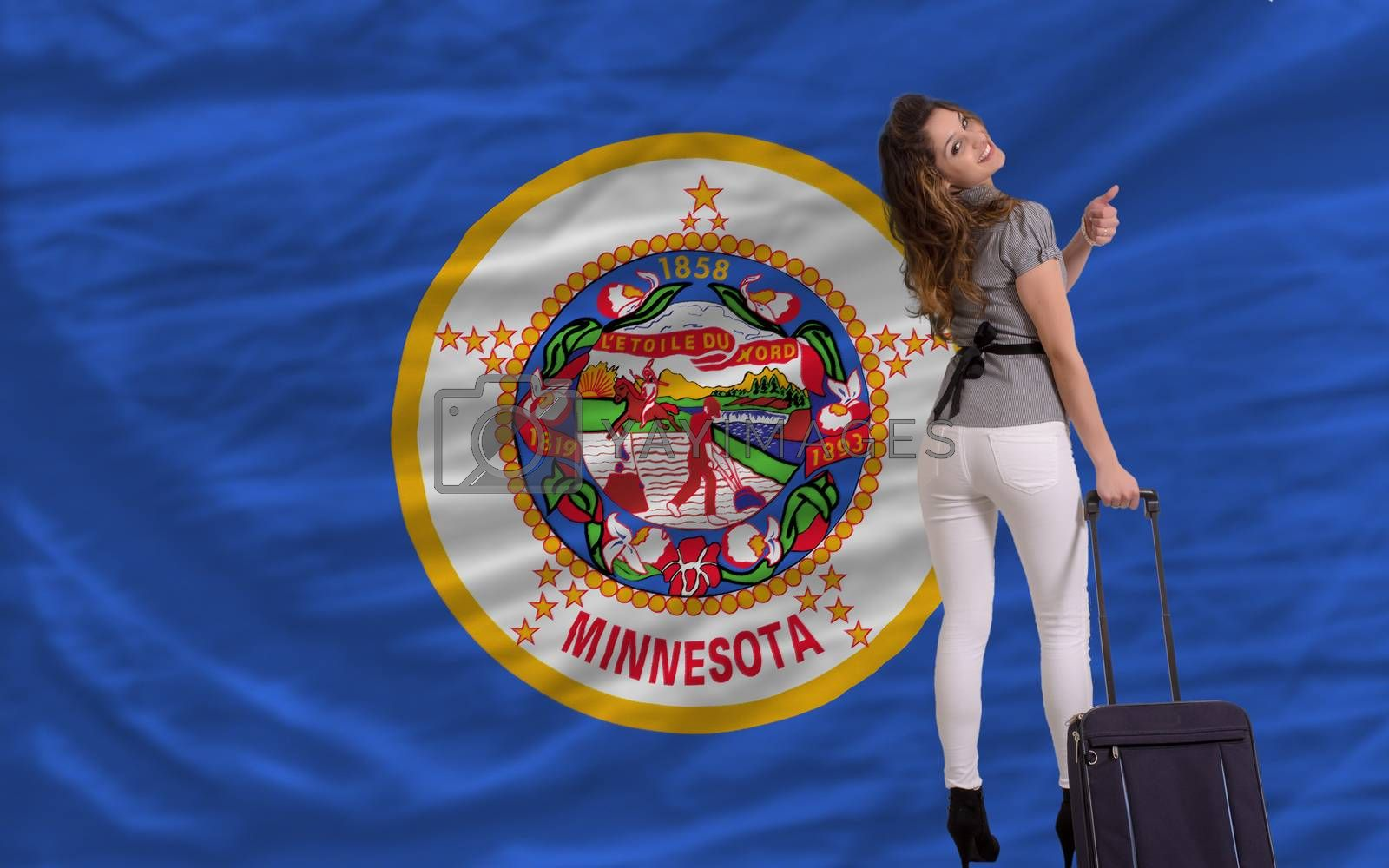 young beautiful woman is traveling to minnesota