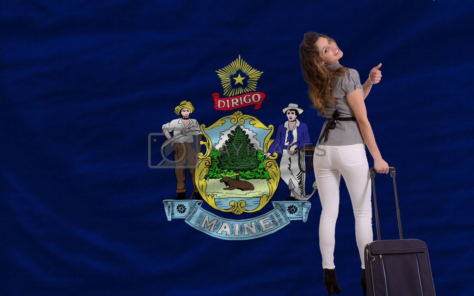 young beautiful woman is traveling to maine