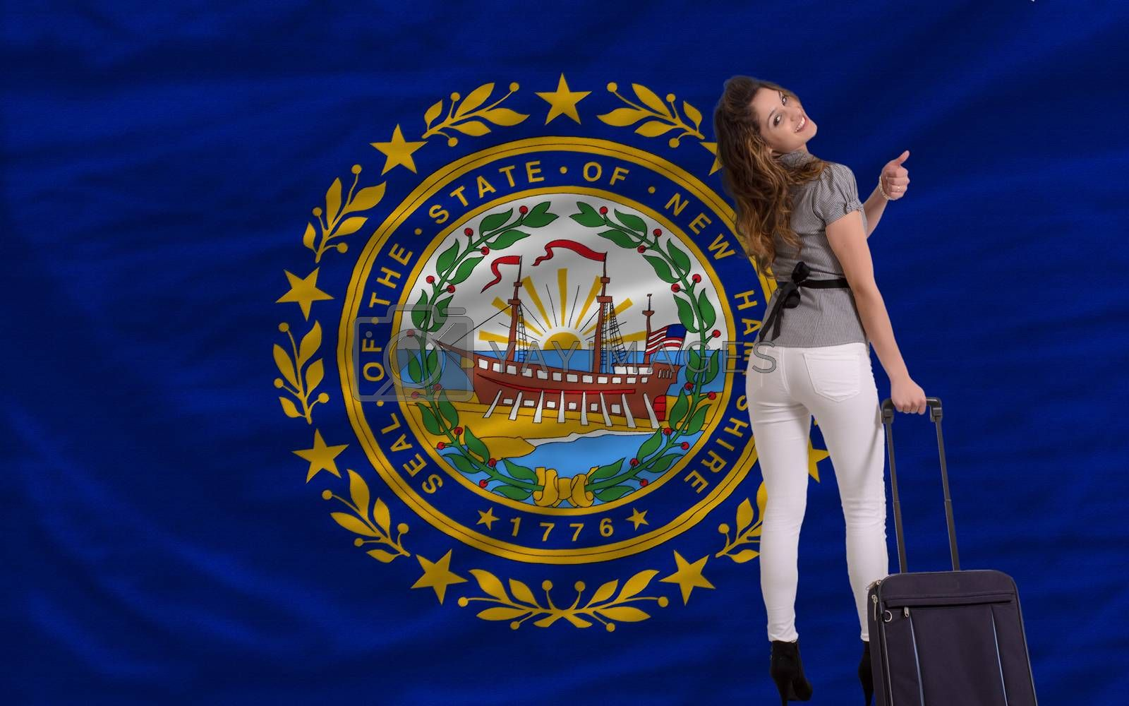 young beautiful woman is traveling to new hampshire