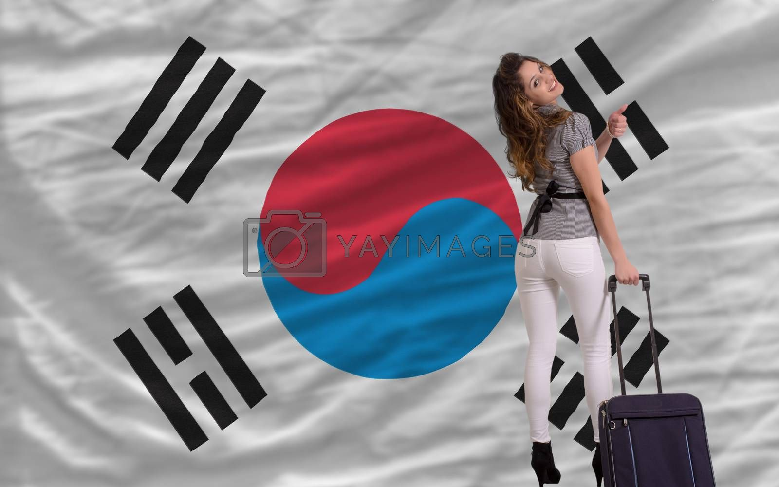young beautiful woman is traveling to south korea