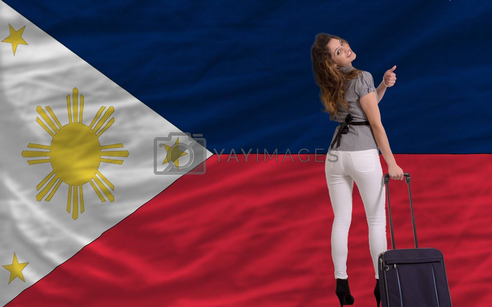 young beautiful woman is traveling to philippines