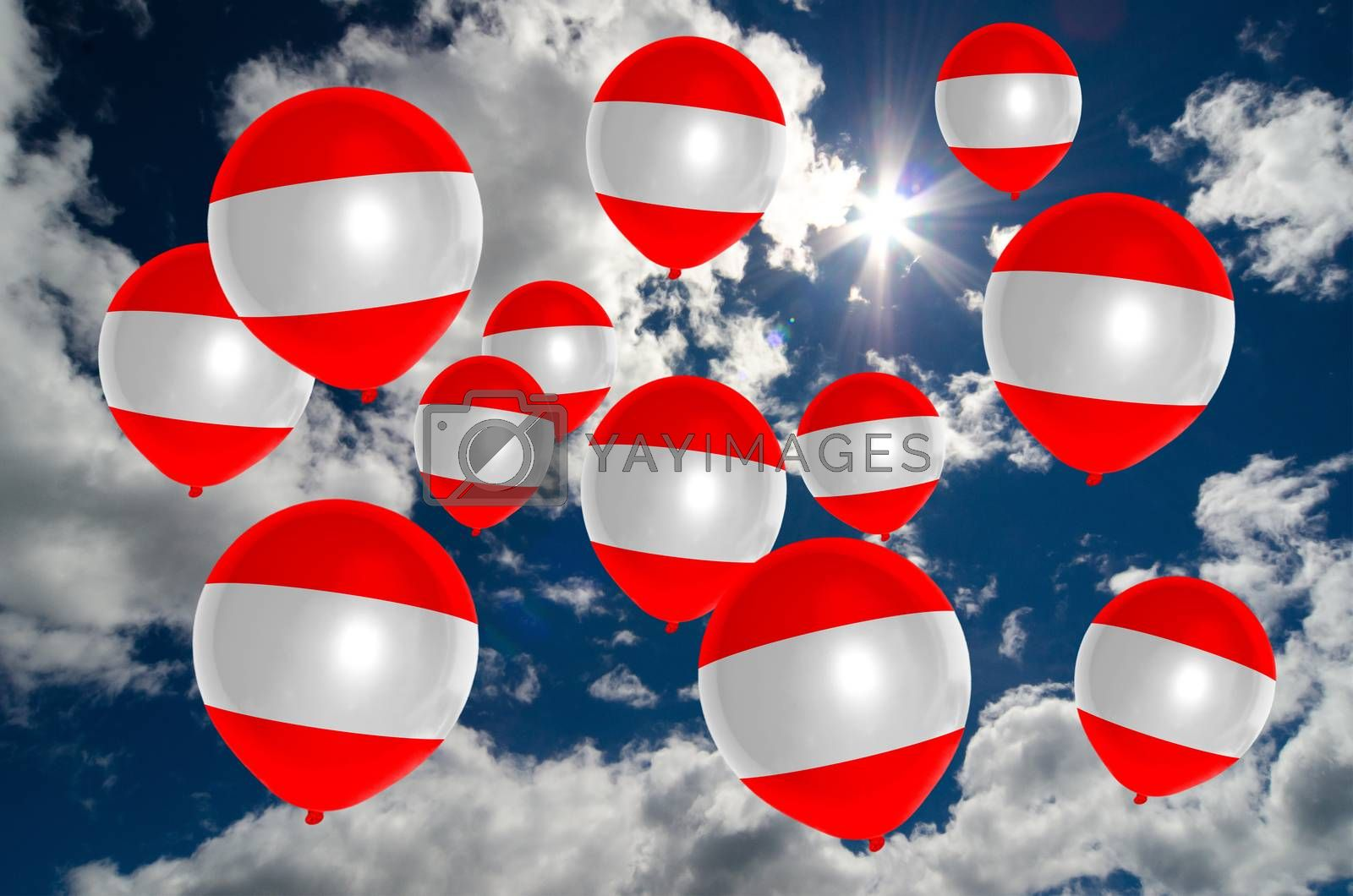 many ballons in colors of austria flag flying on sky