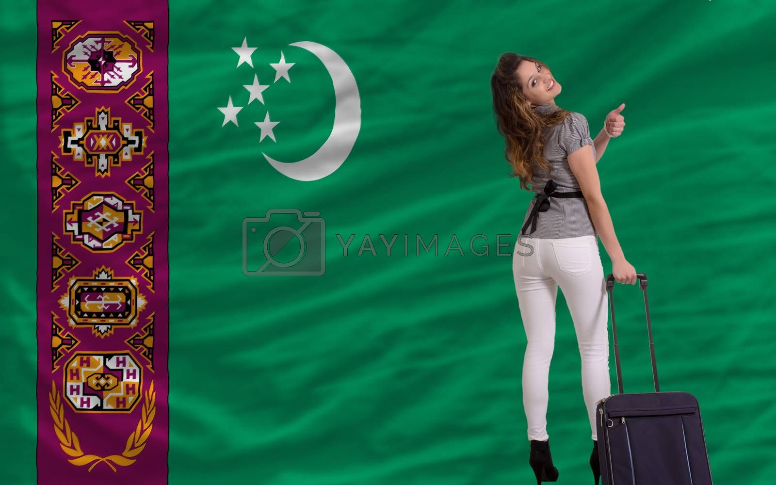 young beautiful woman is traveling to turkmenistan