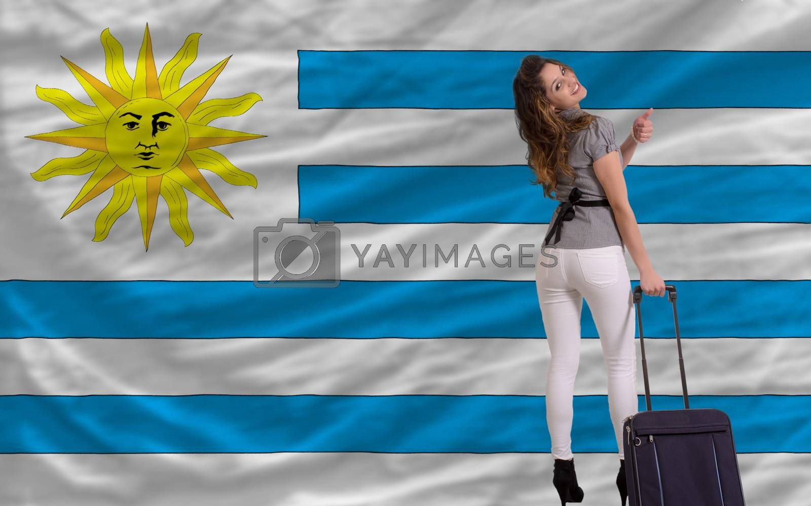 young beautiful woman is traveling to uruguay