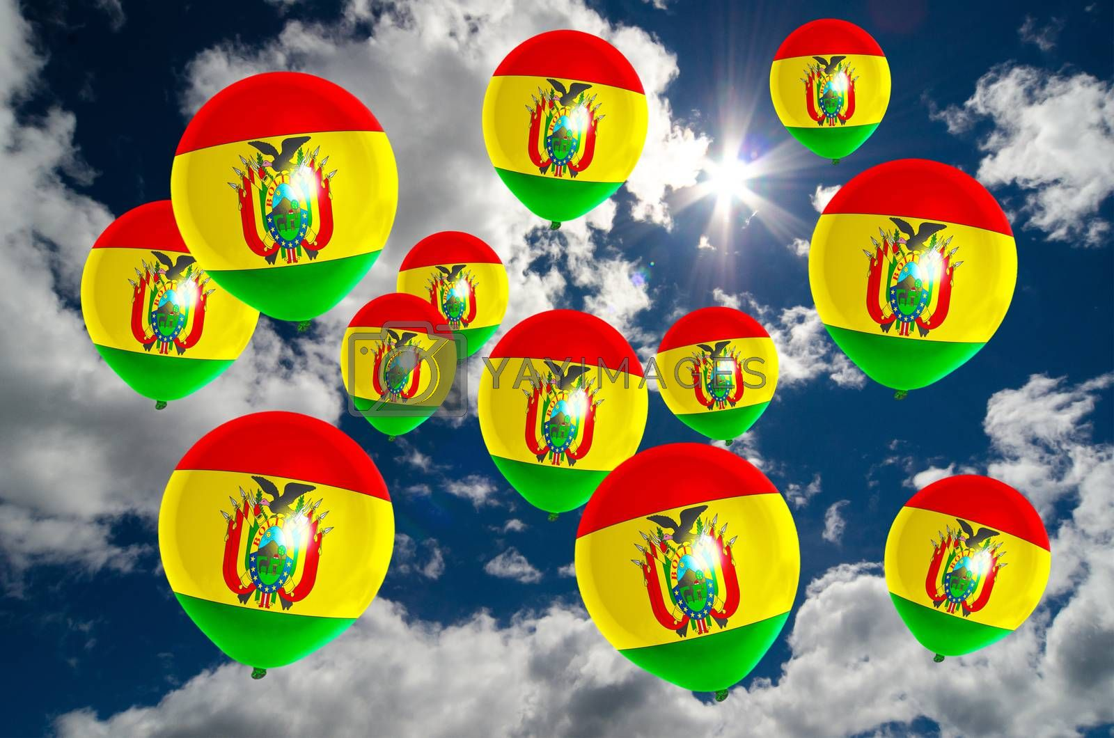 many ballons in colors of bolivia flag flying on sky